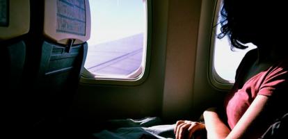 Zo sneak je langs een medepassagier in het vliegtuig